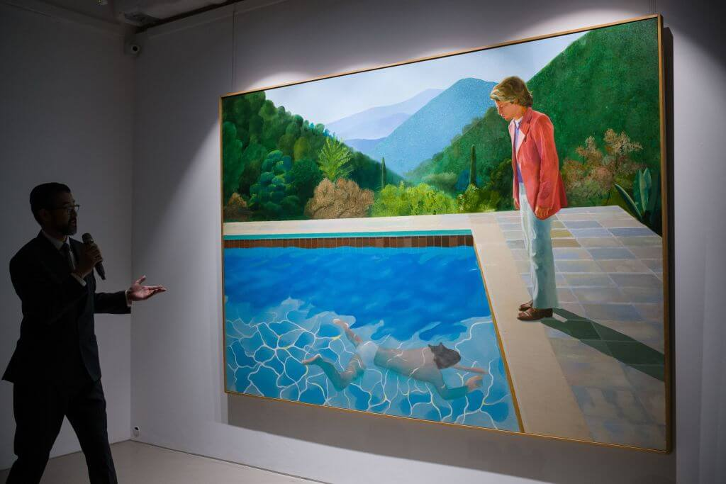 English artist David Hockney's 'Portrait of an Artist (Pool with Two Figures)' is displayed during a Christie's auction preview in Hong Kong on September 27, 2018. - The painting will be auctioned during the Post-War and Contemporary Art Evening Sale on November 15 at Christie's New York with an estimate in the region of 80 million USD. (Photo by Anthony WALLACE / AFP) / RESTRICTED TO EDITORIAL USE - MANDATORY MENTION OF THE ARTIST UPON PUBLICATION - TO ILLUSTRATE THE EVENT AS SPECIFIED IN THE CAPTION (Photo credit should read ANTHONY WALLACE/AFP/Getty Images)