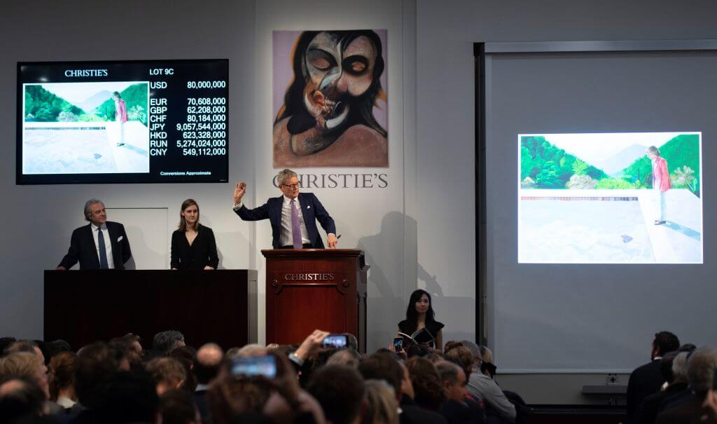 The auctioneer takes bids for the sale of David Hockney's Portrait of an Artist (Pool with Two Figures) during the Post-War and Contemporary Art Evening Sale November 15, 2018 at Christie's in New York. - David Hockneys Famed Pool Scene Sells for $90.3 M. at Christies, New Record for Work by Living Artist at Auction. (Photo by Don EMMERT / AFP) (Photo credit should read DON EMMERT/AFP/Getty Images)