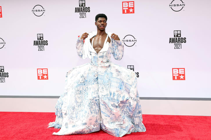 Lil Nas X in a gown on the red carpet.